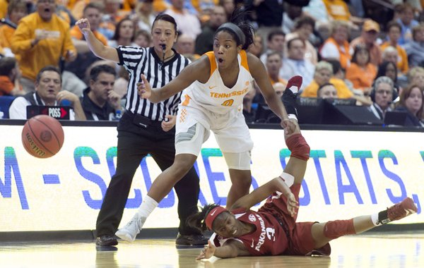 Tennessee's Jordan Reynolds forces the ball away from Arkansas' Malica Monk during an NCAA college basketball game in the Southeastern Conference women's tournament in Jacksonville, Fla., on Thursday, March 3, 2016. (Saul Young/Knoxville News Sentinel via AP)