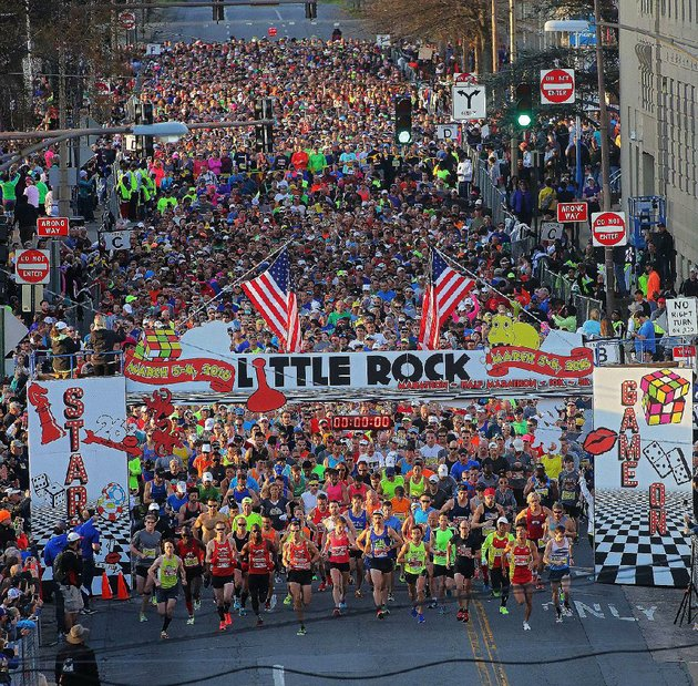 runners-flood-from-the-starting-gates-north-of-scott-street-at-the-beginning-of-the-2016-little-rock-marathon-more-than-5000-participated-in-the-14th-running-of-the-marathon-and-half-marathon-which-began-in-downtown-little-rock-with-a-temperature-of-45-degrees