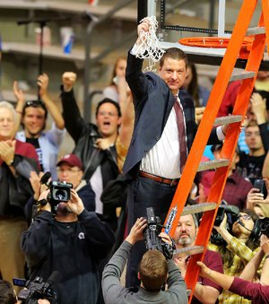 UALR Coach Chris Beard has achieved quite a bit in his fi rst season with the program. The 43-year-old guided the Trojans to their first Sun Belt Conference regular-season title and a school-record 27 victories heading into this week's conference tournament, in which UALR is the top seed for the first time.