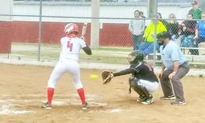 Photographs submitted Lady Blackhawk catcher Sara Whatley catches the pitch during the game Monday in Green Forest.
