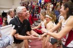 Arkansas coach Lance Harter, left congratulates Leigha Brown, right, after Arkansas won the women's distance medley relay during the Southeastern Conference indoor track and field championships Saturday, Feb. 27, 2016, in Fayetteville, Ark. (AP Photo/Gunnar Rathbun)