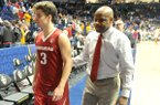 Arkansas guard Dusty Hannahs, left, and head coach Mike Anderson walk off the court following a 68-61 loss to Florida on Thursday, March 10, 2016, during the SEC Tournament at Bridgestone Arena in Nashville, Tenn.