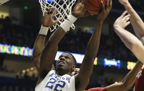Kentucky's Alex Poythress (22) shoots against Alabama during the first half of an NCAA college basketball game in the Southeastern Conference tournament in Nashville, Tenn., Friday, March 11, 2016. (AP Photo/Mark Humphrey)