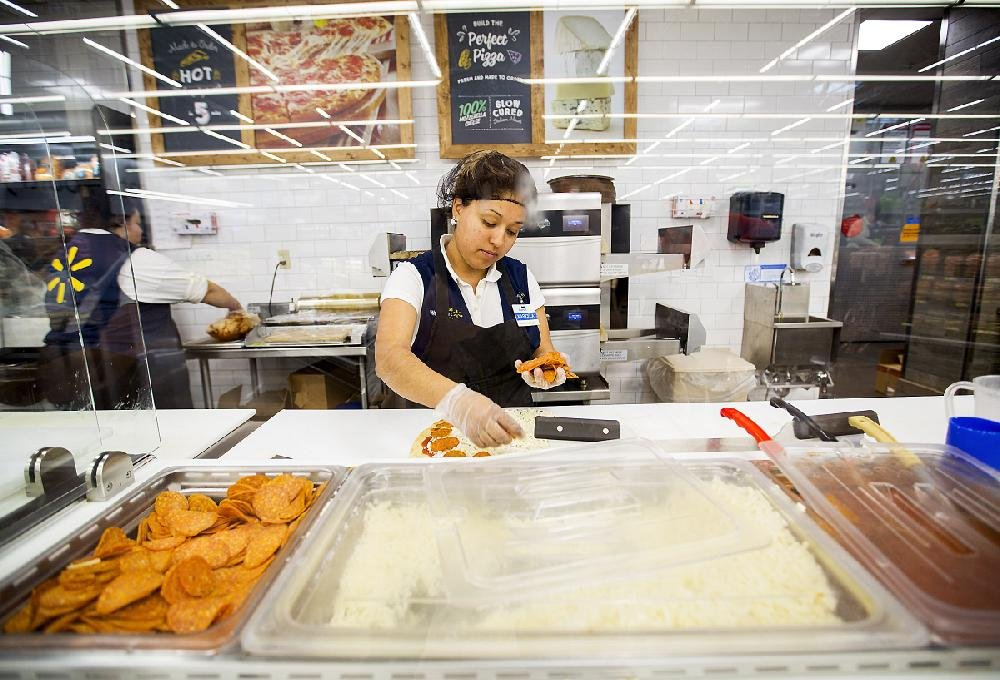 Maricela Mejia Makes Pizza Recently At The Wal Mart Supercenter In Rogers