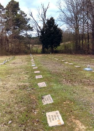 Prison-made headstones mark the graves of about 130 inmates, unclaimed by family or loved ones, at Leek/Drake Cemetery outside Star City.