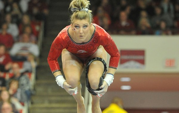 Arkansas gymnast Braie Speed performs on the bars Friday, Jan. 29, 2016, during the Razorbacks' meet against Auburn at Barnhill Arena in Fayetteville.