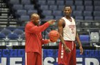 Arkansas coach Mike Anderson, left, and junior Moses Kingsley go through practice Wednesday, March 9, 2016, at Bridgestone Arena in Nashville, Tenn.