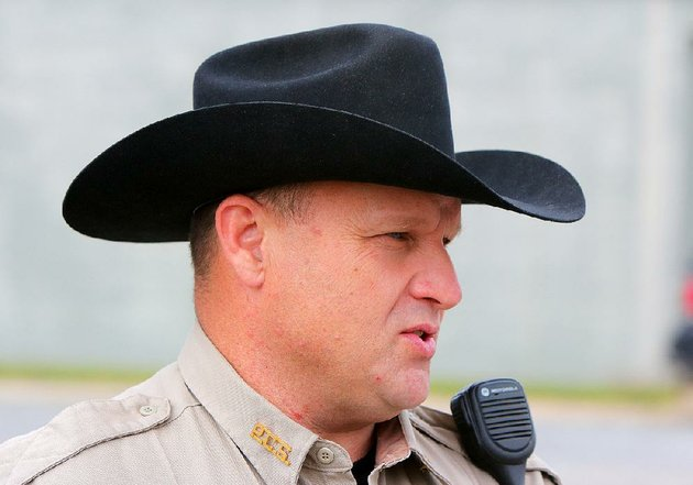 i-like-the-hat-pulaski-county-sheriffs-deputy-ed-johnson-says-of-his-county-issued-cowboy-hats-i-wear-one-off-duty-it-makes-me-feel-better-to-put-it-on