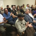 Fayetteville residents at Monday evening's Ward 4 meeting applaud a resident's call for Alderman Joh...