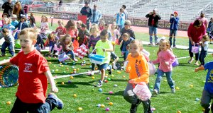 And they're off — childran ran onto the field to gather eggs, then gathered with family members to collect the candy from the eggs after the egg hunt Saturday.