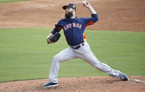 Houston Astros' starting pitcher Dallas Keuchel throws during the first inning of an exhibition spring training baseball game against the New York Mets, Thursday, March 24, 2016, in Port St. Lucie, Fla. (AP Photo/Brynn Anderson)