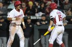 Arkansas shortstop Michael Bernal (left) celebrates after scoring against Missouri with Jake Arledge Friday, April 1, 2016, during the sixth inning at Baum Stadium in Fayetteville.