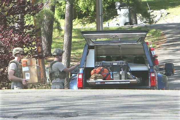 a-little-rock-air-force-base-eod-team-loads-into-their-vehicle-on-woodbeery-street-what-was-initially-believed-to-have-been-an-old-cannonball-or-landmine-found-on-an-excavation-site-near-danville-the-sentinel-recordrichard-rasmussen