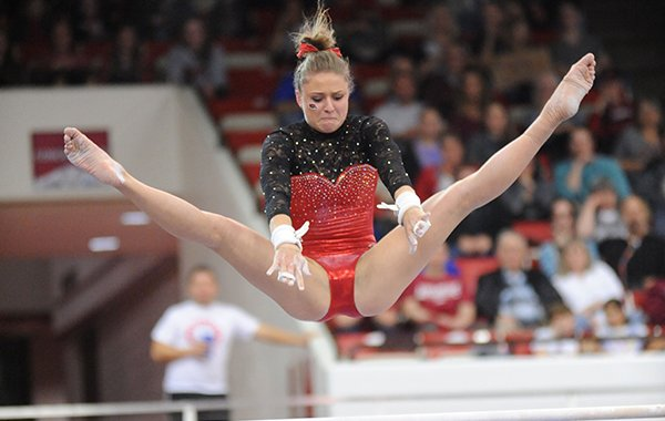 Arkansas' Amanda Wellick competes Friday, March 11, 2016, in the bars rotation during the 11th-ranked Razorbacks' meet with Utah State in Barnhill Arena in Fayetteville.