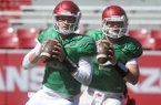 Arkansas quarterbacks Austin Allen and Rafe Peavey go through warmups during practice Saturday, April 2, 2016, at Razorback Stadium in Fayetteville.