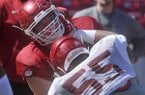 Arkansas linemen Frank Ragnow (72) and Jeremiah Ledbetter (55) run drills during practice Saturday, April 2, 2016, at Razorback Stadium in Fayetteville.