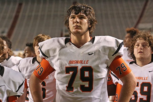 Nashville offensive lineman Kirby Adcock waits as he is announced MVP of the class 4A state championship game on Saturday, Dec. 12, 2015, at War Memorial Stadium in Little Rock.