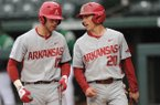 Arkansas' Carson Shaddy (20) talks to Luke Bonfield (17) during the Razorbacks' game against Mississippi Valley State on Tuesday, Feb. 23, 2016, at Baum Stadium in Fayetteville.