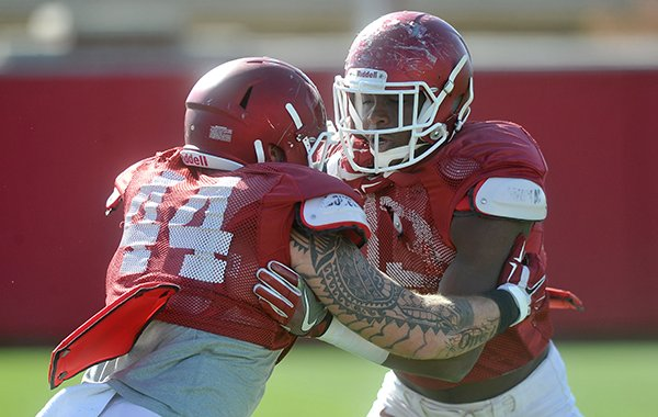 Arkansas tight ends Jeremy Sprinkle (83) and Austin Cantrell (44) go through drills during practice Thursday, April 7, 2016, in Fayetteville.