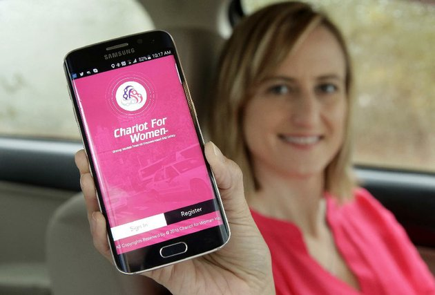 kelly-pelletz-of-charlton-mass-co-creator-of-the-ride-hailing-service-chariot-for-women-displays-the-app-on-a-mobile-phone-in-charlton-earlier-this-month