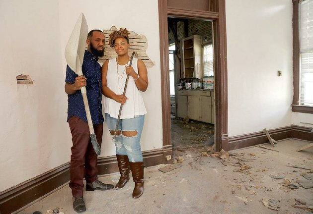 chris-james-left-and-sandrekkia-morning-are-two-members-of-the-roots-art-connection-who-are-helping-renovate-a-house-at-1020-w-21st-st-in-little-rock-james-is-the-executive-director-of-the-nonprofit