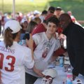 Colton Myers, 16, of Springdale poses Saturday with former Arkansas quarterback Greg Thomas as his a...