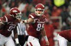 In this Nov. 27, 2015, file photo, Arkansas' Hunter Henry (84) points to his teammate during the first half of an NCAA college football game against Missouri in Fayetteville, Ark. (AP Photo/Samantha Baker)