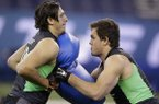 Arkansas tight end Hunter Henry, right, and Stanford tight end Austin Hooper run a drill at the NFL football scouting combine on Saturday, Feb. 27, 2016, in Indianapolis. (AP Photo/Darron Cummings)