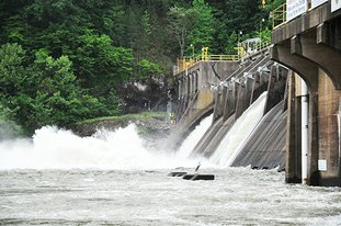 The Sentinel-Record/Mara Kuhn REMMEL DAM: Entergy Arkansas Inc. continued to release water through the spillway gates at Remmel Dam into the Ouachita River on Monday after heavy weekend rains raised Lake Ouachita, located upstream of the dam, into the flood pool. Releases from Blakely Mountain Dam, which forms Ouachita, have to be done in conjunction with releases from Remmel and Carpenter Dam, which forms Lake Hamilton.