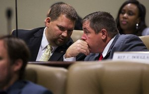 Rep. Jim Dotson (left) talks with Rep. Richard Womack after Dotson's amendment seeking restrictions on the use of assistance to needy families was endorsed Tuesday by the Joint Budget Committee.