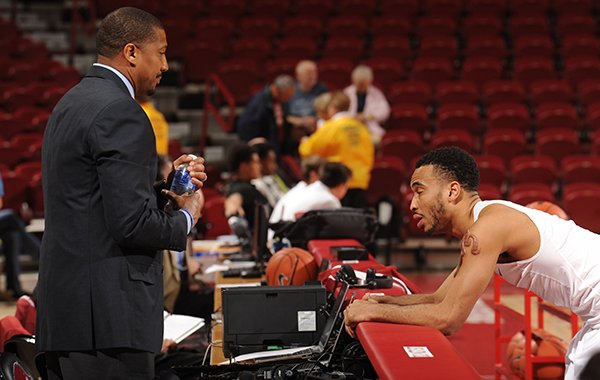 Scotty Thurman, director of student-athlete development, speaks with guard Jabril Durham before playing North Florida Tuesday, Dec. 22, 2015, in Bud Walton Arena in Fayetteville.