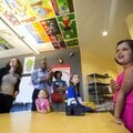 Adithi Sabariprasap, Mary Mae Jones Elementary School first-grader, leads a tour Thursday of the art...