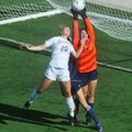 Rogers Heritage goalkeeper Micayla Fought (right) knocks away an entry pass before Fayetteville's My...