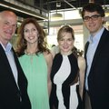 Tim and Heather Marrin (from left) and Jaime and Clark Frye help represent Procter & Gamble at the B...