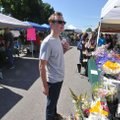Payton Parker with the Springdale Planning Commission picks up a bouquet of flowers Saturday May 7, ...