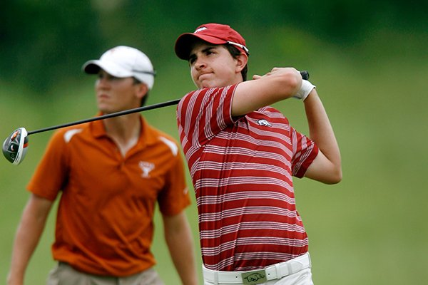 Arkansas' Nicolas Echavarria hits from the 18th tee during the final round of the NCAA men's golf regional on Saturday, May 18, 2013, at The Blessings Golf Club in Fayetteville.