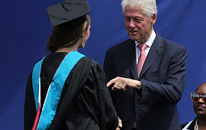 Former President Bill Clinton talks with graduate Berkeley Anderson during the 2016 Clinton School of Public Service commencement ceremony Sunday in Little Rock.