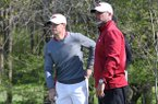 Arkansas coach Brad McMakin, right, talks with senior Taylor Moore during the final round of an NCAA regional on Wednesday, May 18, 2016, at Blackwolf Run Meadow Valleys golf course in Kohler, Wis.