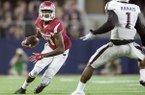 Arkansas junior wide receiver Dominique Reed tries to get around Texas A&M senior cornerback De'Vante Harris on Saturday, Sept. 26, 2015, at AT&T Stadium in Arlington, Texas.