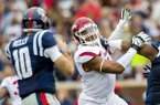 Arkansas defensive lineman Deatrich Wise tries to get to Ole Miss quarterback Chad Kelly on Saturday, Nov. 7, 2015, during the first quarter at Vaught-Hemingway Stadium in Oxford, Miss.