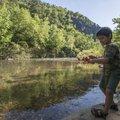 Lucio Reyes, 6, skips rocks along the Buffalo River.