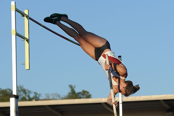 Arkansas' Lexi Weeks competes in the pole vault Saturday, April 23, 2016, during the John McDonnell Invitational at John McDonnell Field in Fayetteville.