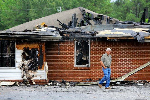 phillip-roark-walks-away-from-a-burned-classroom-area-wednesday-outside-poyen-missionary-baptist-church-which-was-damaged-in-a-fire-tuesday-evening-no-injuries-were-reported-but-the-poyen-churchs-sanctuary-offices-and-classrooms-were-ruined-more-photos-are-available-at-arkansasonlinecomgalleries