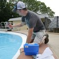 Byron Humphry, parks maintenance superintendent for Fayetteville, draws water Thursday at the Wilson...