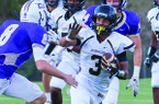 Pulaski Robinson receiver Nathan Page prepares to stiff arm Central Arkansas Christian defender Justin Flanigan during a game Friday, Sept. 11, 2015, at Mustang Mountain in North Little Rock.