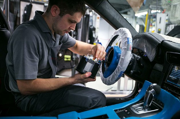 an-employee-prepares-an-air-bag-unit-for-a-porsche-911-at-porsche-ags-factory-in-stuttgart-germany-in-this-file-photo-recalls-for-12-million-more-vehicles-to-replace-potentially-faulty-air-bag-inflators-made-by-takata-corp-were-announced-friday