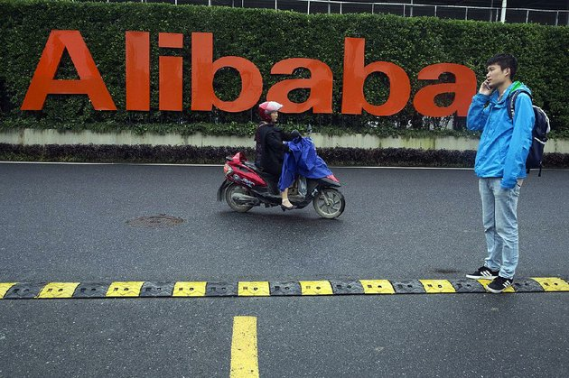 traffic-passes-alibaba-group-headquarters-in-hangzhou-in-eastern-chinas-zhejiang-province-on-friday