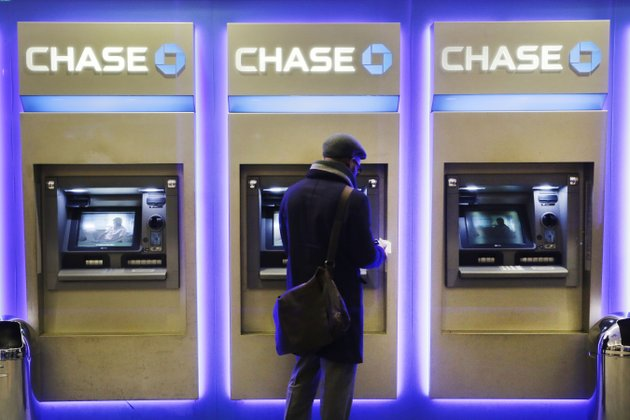 in-this-wednesday-jan-14-2015-file-photo-a-customer-uses-an-atm-at-a-branch-of-chase-bank-in-new-york