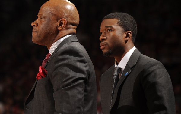 Arkansas coach Mike Anderson (left) and assistant coach T.J. Cleveland direct their team against Missouri Saturday, Feb. 20, 2016, during the second half of play in Bud Walton Arena in Fayetteville.