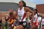 Arkansas runner Taylor Ellis-Watson heads down the home stretch in the women's 400-meter preliminaries Thursday, May 29, 2014, at the 2014 NCAA West Preliminary track meet at John McDonnell Field in Fayetteville.